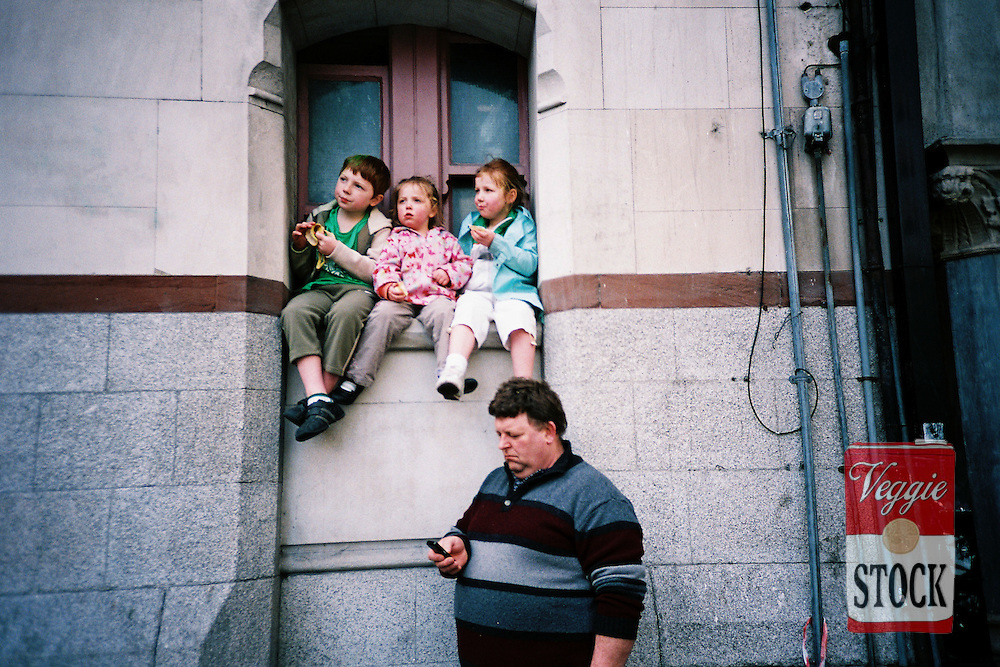 A family watch the parade along Dame Steet during St. Patricks Day in Dublin, March 17, 2009.