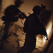 28 June 2004.Baqouba, Iraq.US troops on streets of Baqouba.In the early hours of June 28 before the suprise anouncment that the handover of Soveriegnty from the US led coalition to an Iraqi Government would tke place two days early US troops in Baqouba are on the streets conducting searches of suspicious buildings and 'flash TCP's' or suprise traffic control points. Having been involved in heavy combat in the area in recent times they are aware of the presence of anti-coalition insugents and have first hand experience of their firepower. Their missions within this area of operation will continue as before the handover. This will include stopping and seaching vehicles and entering building they suspect of housing rebel fighters or their weapons.