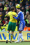 Picture by Paul Chesterton/Focus Images Ltd.  07904 640267.21/01/12.Grant Holt of Norwich and Jose Bosingwa of Chelsea in action during the Barclays Premier League match at Carrow Road Stadium, Norwich.