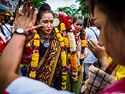 30 SEPTEMBER 2017 - BANGKOK, THAILAND:  People pray during the Navratri parade in Bangkok. Navratri is a nine night (10 day) long Hindu celebration that marks the end of the monsoon and honors of the divine feminine Devi (Durga). The festival is celebrated differently in different parts of India, but the common theme is the battle and victory of Good over Evil based on a regionally famous epic or legend such as the Ramayana or the Devi Mahatmya. Navratri is celebrated throughout Southeast Asia in communities that have large Hindu population. Bangkok's celebration of Navratri was subdued this year because Thais are still mourning the death of Bhumibol Adulyadej, the Late King of Thailand, who died on October 13, 2016.     PHOTO BY JACK KURTZ