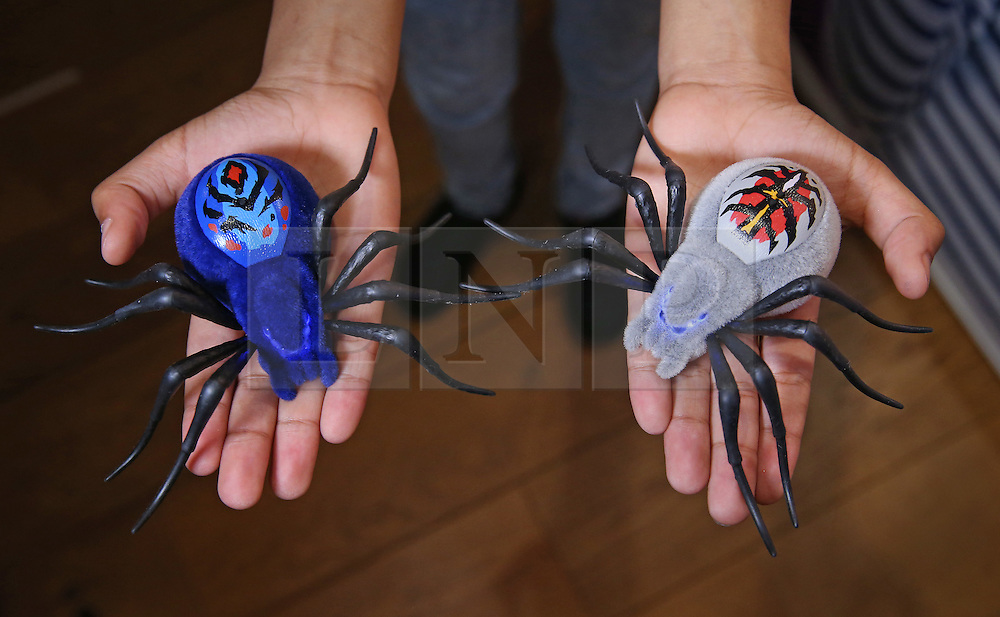 © Licensed to London News Pictures. 04/11/2015. London, UK. 'Wild Pets' robot spiders are shown at the Dream Toys Christmas event. Photo credit: Peter Macdiarmid/LNP