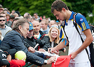 (R) Jerzy Janowicz Junior of Poland with his father (L) Jerzy Janowicz Senior after men's singles Day Sixth during The French Open 2013 at Roland Garros Tennis Club in Paris, France.<br />
