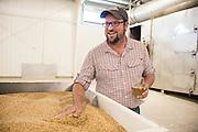 Seth Klann in the malting facility at his family farm, Mecca Grade Estate Malt, in Madras, Oregon.