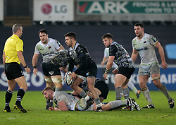 Ospreys' Rhys Webb kicks the ball dead to finish the match<br /> <br /> Photographer Simon King/Replay Images<br /> <br /> European Rugby Champions Cup Round 5 - Ospreys v Saracens - Saturday 13th January 2018 - Liberty Stadium - Swansea<br /> <br /> World Copyright © Replay Images . All rights reserved. info@replayimages.co.uk - http://replayimages.co.uk