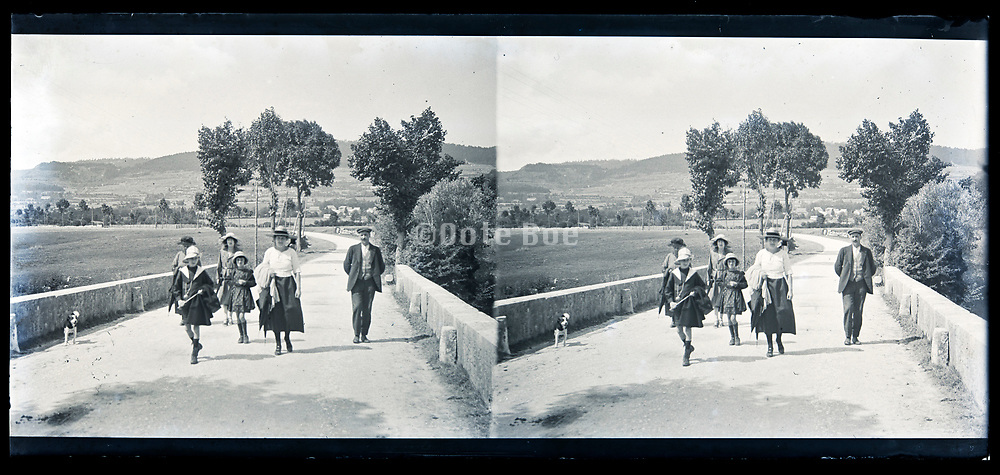 idyllic landscape with people walking on a road France circa 1920s