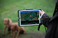 An iPad with an app with flight data of a falcon belonging to one of the members during a meet of the Cheshire Hawking Club at Brimstage, Wirral.