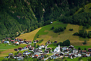 Swiss scene church and village of Surrein in mountain pass in the Graubunden region of Switzerland