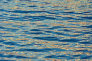 Ripples in water along the North Shore of the Gulf of St. Lawrence at sunset<br />