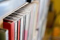 Music CD collection stacked on shelves