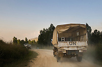 A United Nations vehicle convoy patrols the rough dirt roads of Ituri region, DR Congo. Although heavy conflict in Ituri region ended around 2004, the MONUSCO peacekeeping presence, based in Bunia, is still strong.