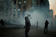 EGYPT, Cairo : Egyptian protesters stand  during clashes with security forces near the Interior Ministry in Cairo, Egypt, Saturday, Feb. 4, 2012..