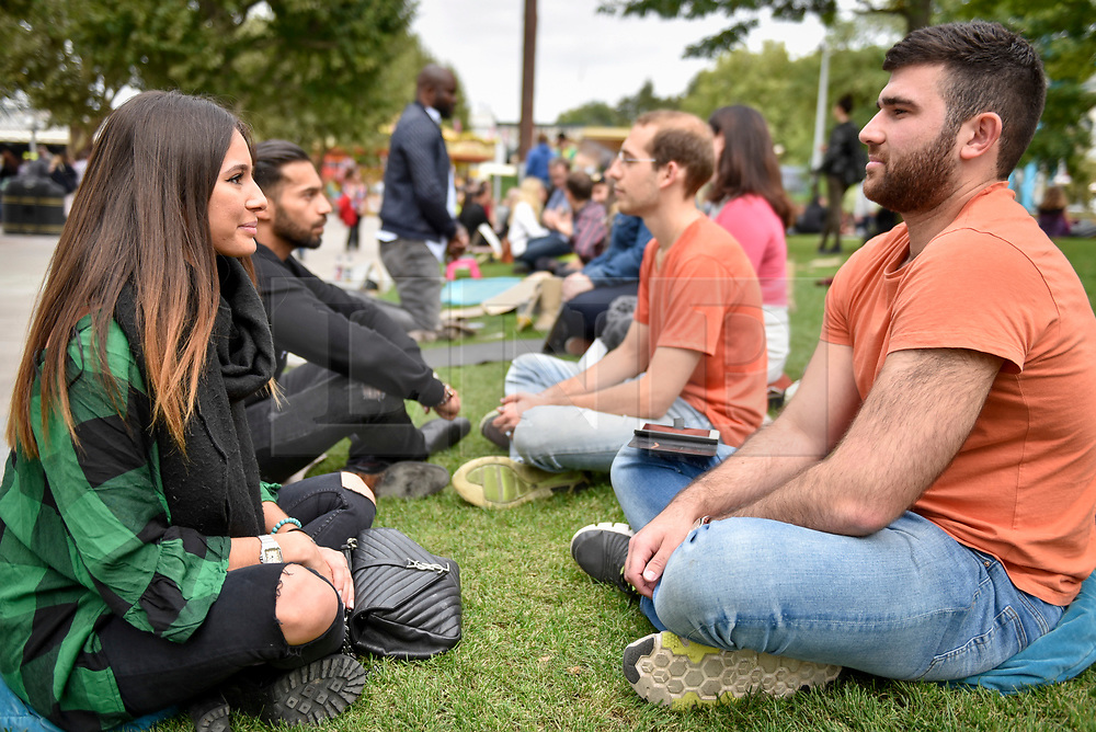 © Licensed to London News Pictures. 23/09/2017. London, UK. People take time to look at each other on Global Eye Contact Day during the UN International Week of Peace.  Sitting down and making eye contact for sixty seconds with another person is designed to improve human connection and a more peaceful world. Photo credit : Stephen Chung/LNP