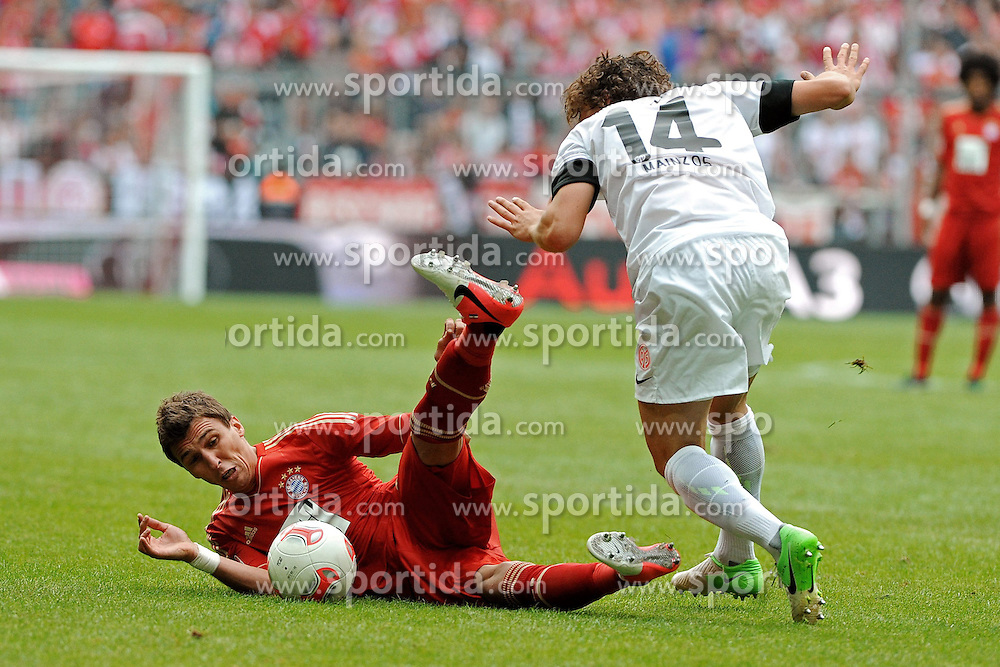 15.09.2012, Allianz Arena, Muenchen, GER, 1. FBL, FC Bayern Muenchen vs 1. FSV Mainz 05, 03. Runde, im Bild Links Mario MANDZUKIC (FC Bayern Muenchen), rechts Julian BAUMGARTLINGER (1.FSV Mainz 05) // during the German Bundesliga 03rd round match between FC Bayern Munich and 1. FSV Mainz 05 at the Allianz Arena, Munich, Germany on 2012/09/15,, , , , . EXPA Pictures © 2012, PhotoCredit: EXPA/ Eibner/ Wolfgang Stuetzle..***** ATTENTION - OUT OF GER *****