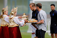 SAINT PETERSBURG, RUSSIA - JUNE 13: England national team head coach Gareth Southgate and Harry Kane (C) accept gifts before an England national team training session ahead of the FIFA World Cup 2018 in Russia at Stadium Spartak Zelenogorsk on June 13, 2018 in Saint Petersburg, Russia.