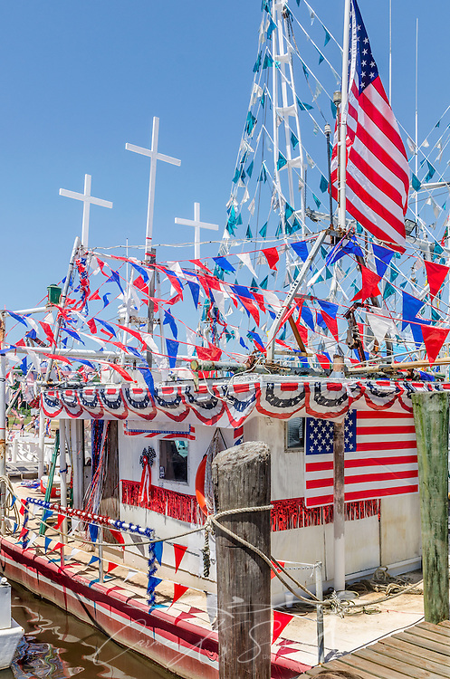 """A decorated boat, """"Why Bother,""""  sits docked during the 65th annual Blessing of the Fleet in Bayou La Batre, Alabama, May 4, 2014. The vessel took third place among the decorated, large commercial boats. The first fleet blessing was held by St. Margaret's Catholic Church in 1949, carrying on a long European tradition of asking God's favor for a bountiful seafood harvest and protection from the perils of the sea. The highlight of the event is a blessing of the boats by the local Catholic archbishop and the tossing of a ceremonial wreath in memory of those who have lost their lives at sea. The event also includes a land parade and a parade of decorated boats that slowly cruise through the bayou. (Photo by Carmen K. Sisson/Cloudybright)"""