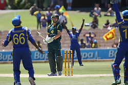 © Licensed to London News Pictures. 08/03/2012. Adelaide Oval, Australia. Matthew Wade looks back at the Sri Lankans as a appeal is turned down by the umpire during the One Day International cricket match final between Australia Vs Sri Lanka. Photo credit : Asanka Brendon Ratnayake/LNP