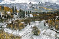 Fresh new snow decorates an autumn landscape along the Cimarron River in the Uncompahgre Range & wilderness; Uncompahgre National Forest, Owl Creek Pass, Colorado