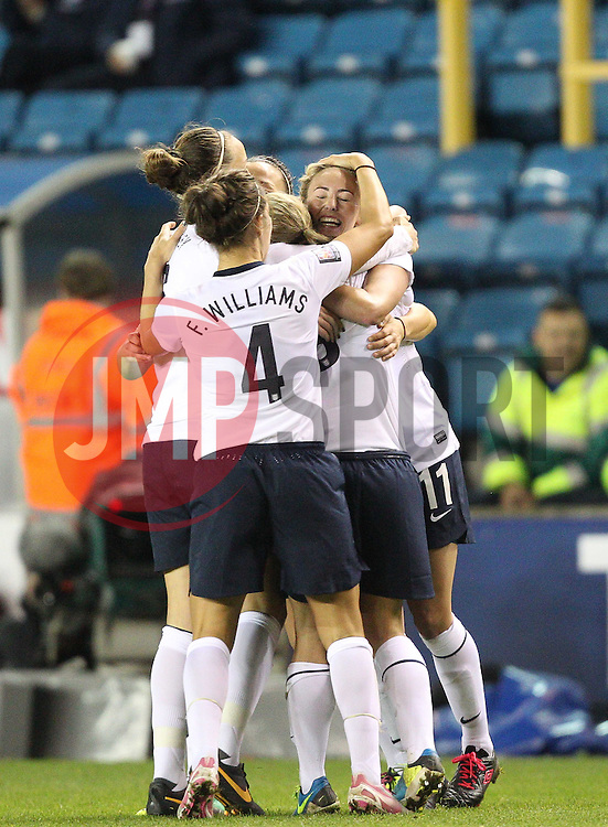 England's Toni Duggan (Everton) is mobbed after scoring her sides second goal - Photo mandatory by-line: Robin White/JMP - Tel: Mobile: 07966 386802 26/10/2013 - SPORT - FOOTBALL - The Den - Millwall - England Women v Wales Women - World Cup Qualifier - Group 6