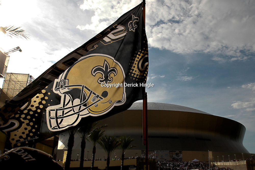 September 9, 2010; New Orleans, LA, USA;  A New Orleans Saints fan waves a flag outside of the Louisiana Superdome in Champions Square prior to kickoff of the NFL Kickoff season opener at the Louisiana Superdome. The New Orleans Saints defeated the Minnesota Vikings 14-9.  Mandatory Credit: Derick E. Hingle