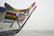 Fishing boats painted with Ghana and USA flags.  Butre Village near Busua. Ghana. West Africa..©Picture Zute Lightfoot.  07939 108077. www.lightfootphoto.co.uk