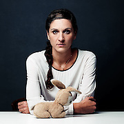 """When refugees unveil their most valuable possession<br /> <br /> For his personal project entitled ImPORTRAITS, photographer Gabriel Hill has produced a series of portraits of refugees, revealing their most valuable possession. <br /> A powerful and moving way of telling their stories through a simple object, be it a picture, a cuddly toy or even a simple piece of paper.<br /> <br /> <br /> Photo Shows: When I was a child, my father would often travel to Africa for work. One time when I was three, I had asked him to bring me back a real-life mon- key, but he brought me a stuffed bunny he had bought for me during a transit at Zurich Airport.<br /> I took that bunny everywhere. When the war began, everything went so fast I could neither understand what was going on nor think about what I wanted to take with me when we  ed. That's how I forgot my bunny when we left. My dad stayed behind, and I wrote him so many letters saying things like, """"Did you  nd my bunny? I miss you!""""<br /> I can't describe how I felt when I saw my father again three years later, in 1995. My whole body was trembling when I saw his face at the airport in Zurich—and saw that he was holding my bunny.""""<br /> ©Gabriel Hill/Exclusivepix Media"""
