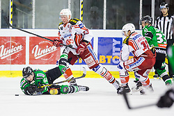 16.12.2014, Hala Tivoli, Ljubljana, SLO, EBEL, HDD Telemach Olimpija Ljubljana vs EC KAC, 28. Runde, in picture Luka Kalan (HDD Telemach Olimpija, #61) and Michael Siklenka (EC KAC, #23) during the Erste Bank Icehockey League 28. Round between HDD Telemach Olimpija Ljubljana and EC KAC at the Hala Tivoli, Ljubljana, Slovenia on 2014/12/16. Photo by Matic Klansek Velej / Sportida