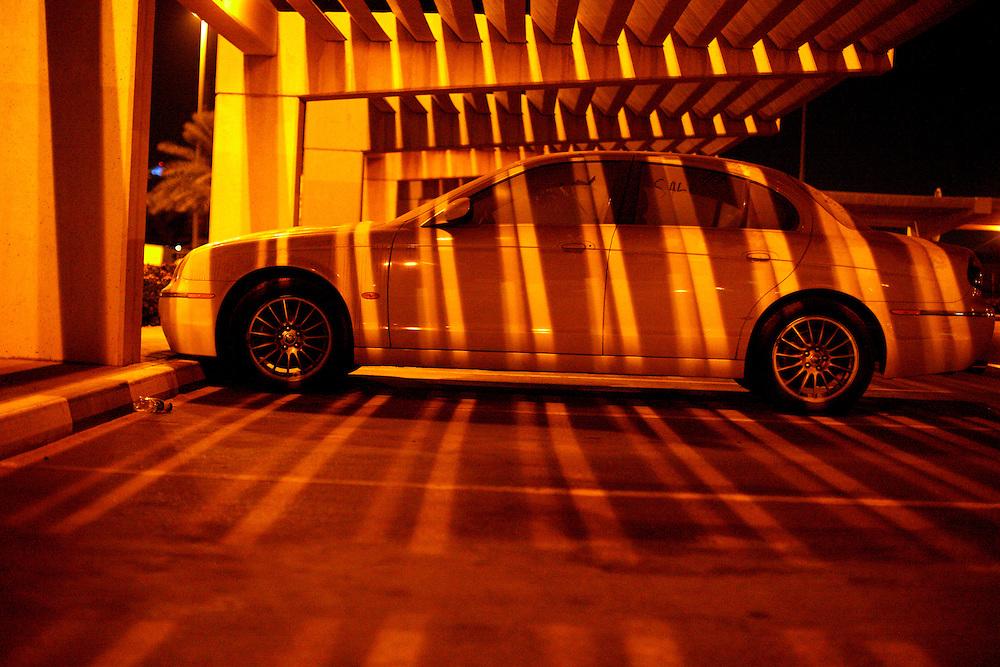 A dusty luxury car (jaguar) at DBX, Dubai International Airport...Photo by: Eivind H. Natvig/MOMENT