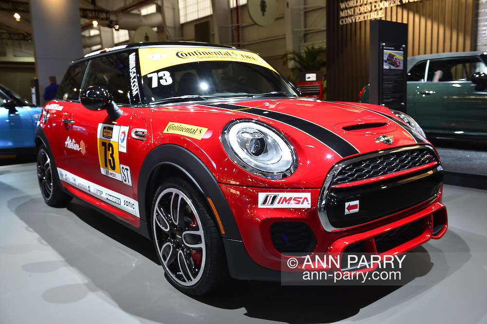 A red MINI Cooper Motorsports sports car, with stickers such as Continental Tire on it, is shown at the New York International Auto Show 2016, at the Jacob Javits Center. The MINI John Cooper Works racing team has 3 cars in the 2016 Continental Tire SportsCar Challenge, and IMSA is the International Motor Sports Association. This was Press Preview Day one of NYIAS, and the Trade Show will be open to the public for ten days, March 25th through April 3rd.