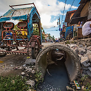 CAPTION: Inadequate drainage and the build of waste is one of the problems contributing to flooding in Marikina. The local government of Marikina have banned plastic and polystyrene in the city, local businesses are following this and Hilda thinks this helps to reduce the impact of flooding. LOCATION: Ampalaya Street, Barangay Tumana, Marikina City, Philippines. INDIVIDUAL(S) PHOTOGRAPHED: N/A.