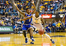 Dec 17, 2016; Morgantown, WV, USA; West Virginia Mountaineers guard Teyvon Myers (0) drives past UMKC Kangaroos guard Xavier Bishop (0) during the second half at WVU Coliseum. Mandatory Credit: Ben Queen-USA TODAY Sports