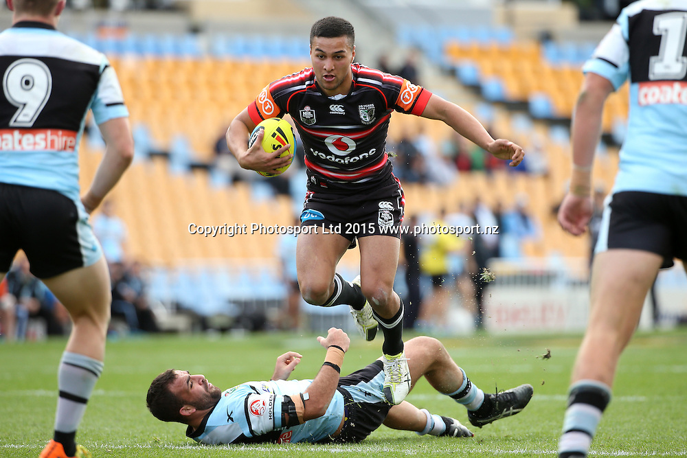 Junior Warriors player Kauri Aupouri leaps over Junior Sharks captain Anthony Moraitis in the Holden Cup Rugby League, Vodafone Warriors v Cronulla Sharks s at Mt Smart Stadium, Auckland, New Zealand. 1 August 2015. Copyright Photo: Fiona Goodall / www.photosport.nz