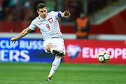 Warsaw, Poland - 2017 October 08: Robert Lewandowski of Poland shoots free kick during soccer match Poland v Montenegro - FIFA 2018 World Cup Qualifier at PGE National Stadium on October 08, 2017 in Warsaw, Poland.<br /> <br /> Mandatory credit:<br /> Photo by &copy; Adam Nurkiewicz / Mediasport<br /> <br /> Adam Nurkiewicz declares that he has no rights to the image of people at the photographs of his authorship.<br /> <br /> Picture also available in RAW (NEF) or TIFF format on special request.<br /> <br /> Any editorial, commercial or promotional use requires written permission from the author of image.