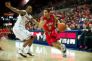 DALLAS, TX - JANUARY 4: Nic Moore #11 of the SMU Mustangs drives to the basket against the Connecticut Huskies on January 4, 2014 at Moody Coliseum in Dallas, Texas.  (Photo by Cooper Neill/Getty Images) *** Local Caption *** Nic Moore