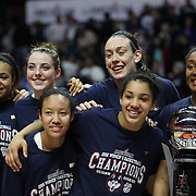 Breanna Stewart, (center. right)), and  Katie Lou Samuelson (center, left) with team mates at the trophy presentation during the UConn Huskies Vs USF Bulls 2016 American Athletic Conference Championships Final. Mohegan Sun Arena, Uncasville, Connecticut, USA. 7th March 2016. Photo Tim Clayton