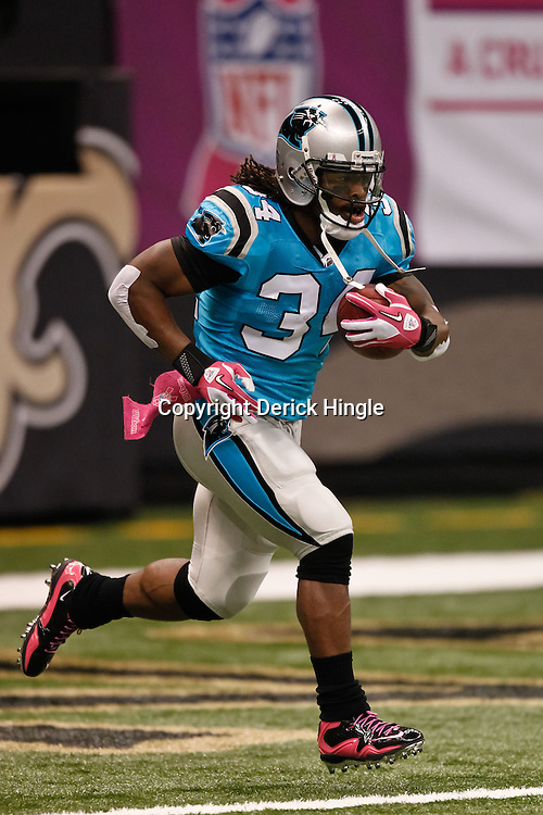 October 3, 2010; New Orleans, LA, USA; Carolina Panthers running back DeAngelo Williams (34) during warm ups prior to kickoff of a game between the New Orleans Saints and the Carolina Panthers at the Louisiana Superdome. Mandatory Credit: Derick E. Hingle
