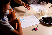 Belo Horizonte_MG, Brasil...Na foto, alunos da da E.E. Leon Renault, leem instrucoes para experiencias em laboratorio...In this photo, students is reading the instructions about laboratory experiments...Foto: LEO DRUMOND / NITRO