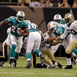 2009 September 03: Miami Dolphins running back Ronnie Brown (23) runs through a hole in the New Orleans Saints defense as Marvin Mitchell (50) pursues during a preseason game between the Miami Dolphins and the New Orleans Saints at the Louisiana Superdome in New Orleans, Louisiana.