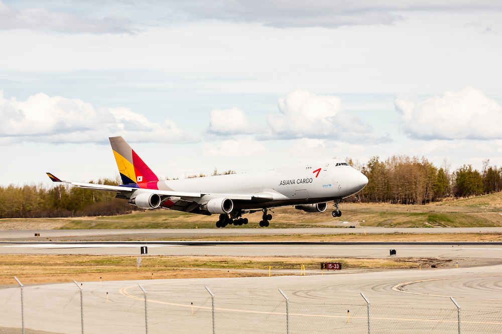 Asiana Cargo jet landing at Ted Stevens Anchorage International Airport in Southcentral Alaska. Spring. Afternoon.
