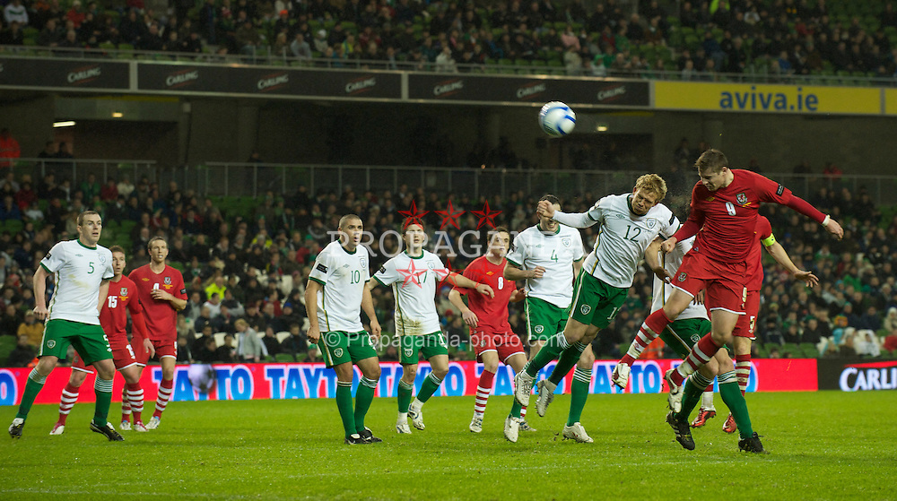DUBLIN, IRELAND - Tuesday, February 8, 2011: Wales' Simon Church and the Republic of Ireland's Paul Green during the opening Carling Nations Cup match at the Aviva Stadium (Lansdowne Road). (Photo by David Rawcliffe/Propaganda)