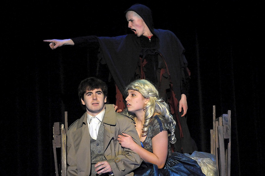 Igor (back), played by Gil Donohue, points out a werewolf to Frederick Frankenstein, played by James Morrison, and Inga, played by Kirstie Mosher, during a scene for this weekends Livonia High School performance of Young Frankenstein