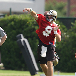 2008 May 21: New Orleans Saints quarterback Drew Brees throws a pass during team organized activities at the Saints training facility in Metairie, LA. .