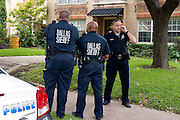 Police stand outside the apartment where a second Ebola patient has been reported in Dallas, Texas on October 12, 2014. (Cooper Neill for The New York Times)