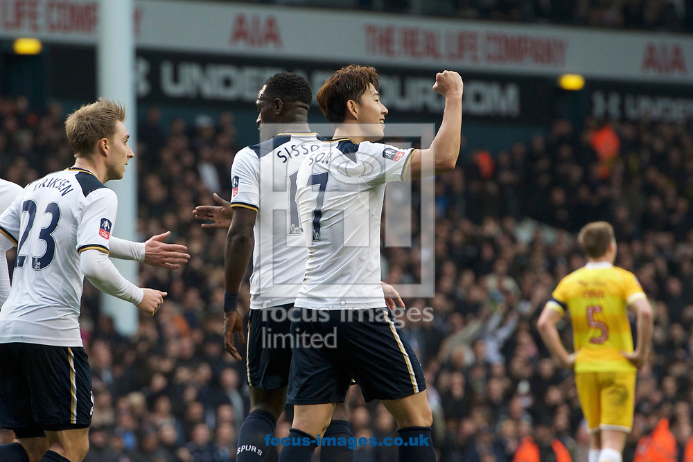 Son Heung-Min of Tottenham Hotspur (right) celebrates after scoring his hat trick to make it 6-0 during the quarter final of the FA Cup match at White Hart Lane, London<br /> Picture by Alan Stanford/Focus Images Ltd +44 7915 056117<br /> 12/03/2017