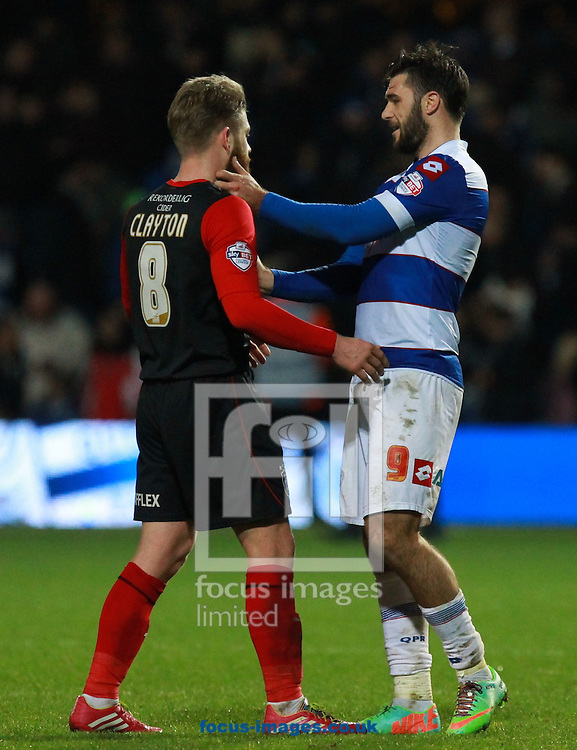 Picture by John Rainford/Focus Images Ltd +44 7506 538356<br /> 18/01/2014<br /> Charlie Austin of Queens Park Rangers and Adam Clayton of Huddersfield Town after the Sky Bet Championship match at the Loftus Road Stadium, London.