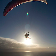 Two men take off from Signal Hill in Cape Town, South Africa for a paragliding venture over the Atlantic Ocean. Signal Hill is