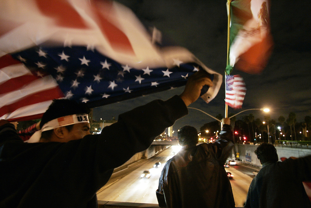 Protestors wave American and Mexican flags over Highway 101 during the National Day of Action immigrant rights demonstration in Los Angeles, CA on Monday, April 10, 2006.<br />