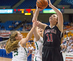 Bluefield center Jia Coppola (11) shoots over Wyoming East guard Kara Sandy (3) during a first round game at the Charleston Civic Center.