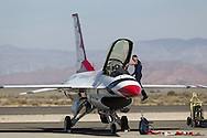 An U.S. Air Force Thunderbirds officer examins a F-16 Fighting Falcon before the performance during Los Angeles County Air Show in Lancaster, California on March 21, 2015. (Photo by Ringo Chiu/PHOTOFORMULA.com)
