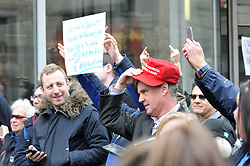 Bystanders are seen waving when the Motorcade of President Trump drives past on 13th and Chestnut Streets in Center City Philadelphia, PA, on January 26th, 2016. When asked for clarification one unidentified man said to be unaware of his gesture and claimed it was not intended to provoke and he was only waving at the President, but added he is a big Trump supporter.