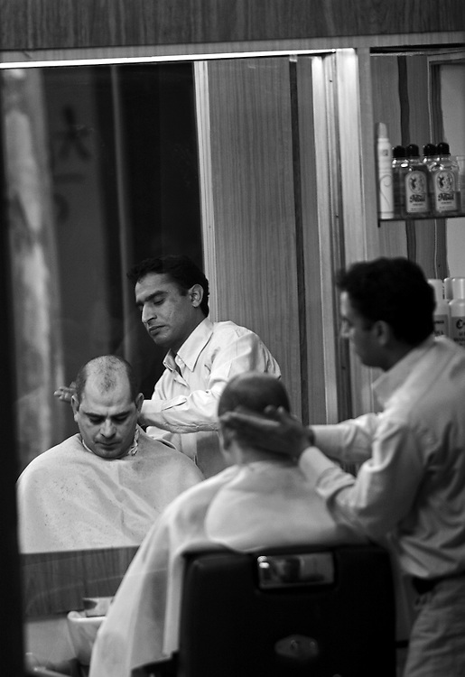 "Black and white photography. A barber at work in Italy by Karl R Lilliendahl photographer.This photo is available as open edition and limited edition giclee print in four sizes. Click on ""Get Print"" to see more details."